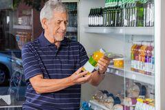 man-reading-information-juice-bottle-senior-supermarket-36510451 dreams