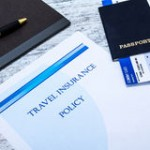 travel-insurance-policy-booklet-boarding-pass-passport-50616179